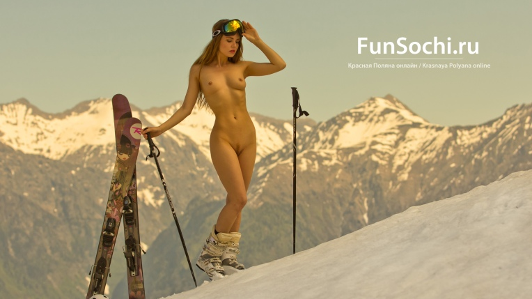 Naked woman sunbathing in the mountains skiing