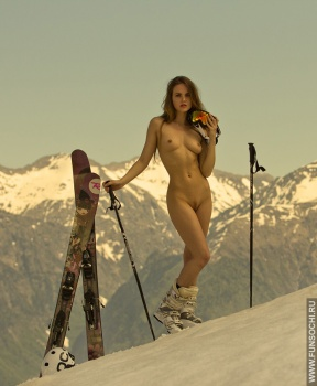 Nude woman in mountains with ski